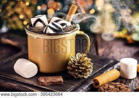 Hot Chocolate With Marshmallow Candies, A Typical Christmas And Holiday Drink, Gold Mug, Lights And