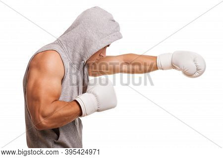 Profile Shot Of A Male Boxer Shadow Boxing Isolated On White. Ripped Muscular Fighter Wearing Hoodie