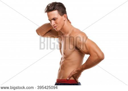 Muscular Man With Back Pain Isolated. Handsome Male Athlete Suffering From Muscle Pain, Rubbing His