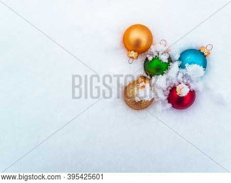 Christmas Tree Toys Colored Balls On White Snow. Christmas Holidays. New Year. Loose Winter Snow. Ne
