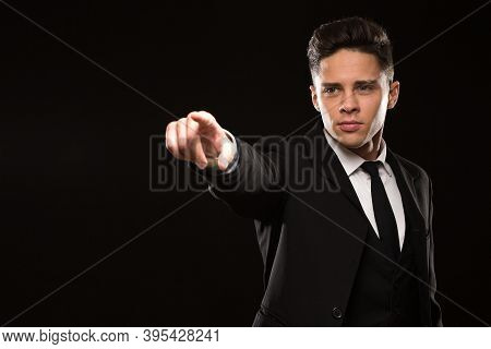 Attractive Young Security Guard Gesturing Pointing Away At Something With His Finger Copyspace Lifes