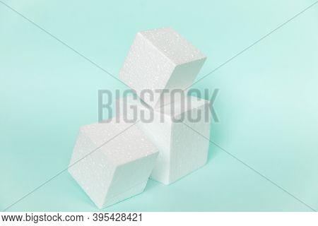 White Rectangular Cube Shapes On Blue Background. Minimal Boxes Geometric Forms Podium. Empty Unbran