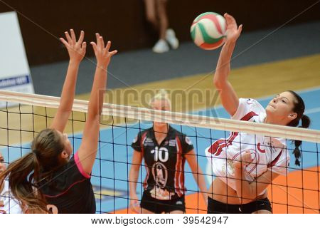 KAPOSVAR, HUNGARY - OCTOBER 14: Zsofia Harmath (R) in action at the Hungarian I. League volleyball game Kaposvar (white) vs Nyiregyhaza (black), October 14, 2012 in Kaposvar, Hungary.