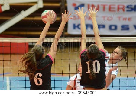 KAPOSVAR, HUNGARY - OCTOBER 14: Ildiko Szivos (R) in action at the Hungarian I. League volleyball game Kaposvar (white) vs Nyiregyhaza (black), October 14, 2012 in Kaposvar, Hungary.
