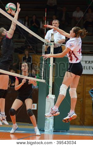 KAPOSVAR, HUNGARY - OCTOBER 14: Agnes Recsei (R) in action at the Hungarian I. League volleyball game Kaposvar (white) vs Nyiregyhaza (black), October 14, 2012 in Kaposvar, Hungary.