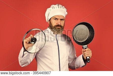 Baking Process. Bearded Man Hold Frying Pan. Cooking In Pot. For Preparing Food. Bearded Man Cooking