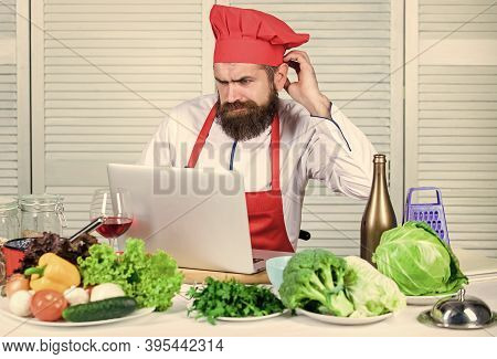 Elearning Concept. Man Chef Searching Internet Recipe Cooking Food. Chef Laptop Read Culinary Recipe