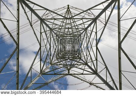 Industrial Electrical Transmission Lines And Pylon Tower. Repeating, Converging And Intricate Patter