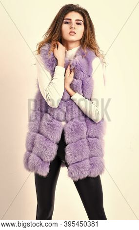 Luxury Fur Clothes For Female. Girl Curly Hairstyle Enjoy Soft Warm Violet Furry Coat. Fashion Trend