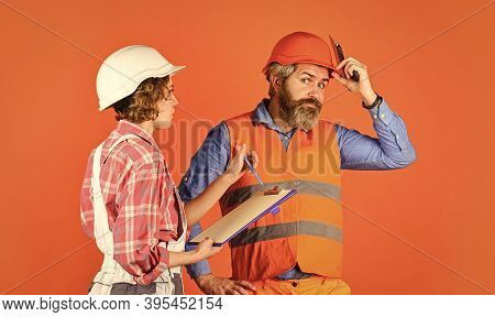 Renovation Concept. Price List. Couple Look Documents. Woman And Man Safety Hard Hat. Couple Plannin