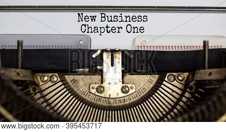 Text 'new Business, Chapter One' Typed On Retro Typewriter. Business Concept. Beautiful Background.