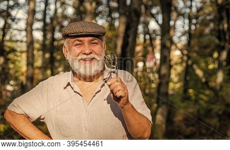 Eye Care. Happy Pensioner Hold Glasses In Nature. Old Man Have Long Sight. Old Age Sight. Failing Si
