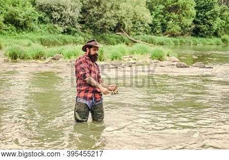 Satisfied Fisher. Fisher Masculine Hobby. Fisher Fishing Equipment. Fish On Hook. Fishing Requires Y