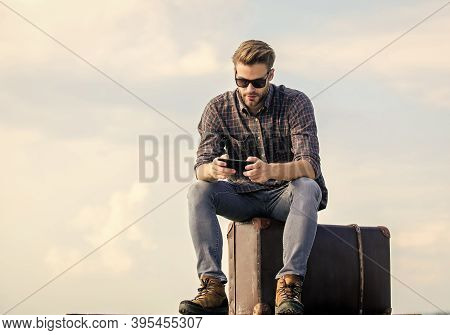 Luggage Concept. Calling Taxi. Travel Agency. Travel With Luggage. Travel Blogger. Man Sit On Suitca