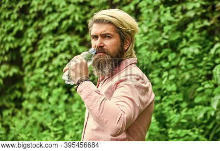 Drinking Water. Handsome Man Drinking Fresh Water From Bottle. Morning Routine. Daily Intake Of Wate