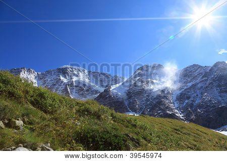 Green Grass, Glaciers, Peaks And Sun
