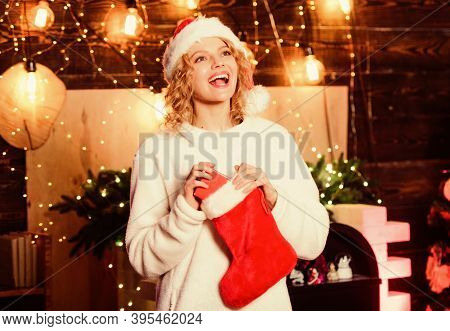 Christmas Present. Happy New Year. Gifts From Santa Claus. Girl In Red Santa Hat. Winter Holidays De