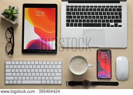 Mykolaiv, Ukraine - August 27, 2020: Flat Lay Composition With Iphone 11, Macbook Laptop And Ipad Ta