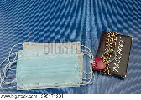 Chain With A Heart-shaped Lock On The Passport. Code Lock With Chain On The Passport As A Symbol Of
