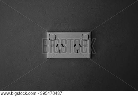 Australian Power Socket Outlet On Dark Grey Background, Power Socket On Dusty Grey Painted Wall, Two