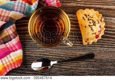 Checkered Napkin, Transparent Cup With Tea, Teaspoon, Shortbread Cookie With Raspberry Jam And Linse