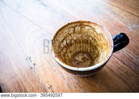 Empty Coffee Cup On The Wood Table Close Up View