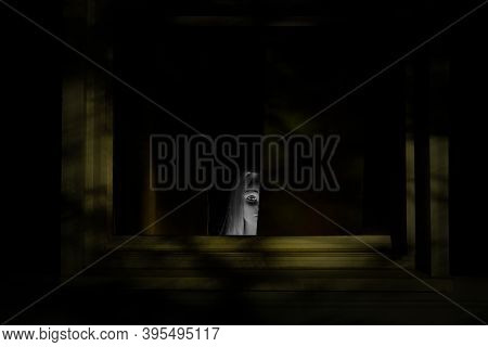 A Spooky Image, With A Mannequin Head Of A Little Ghost Girl Peeking From Behind A Curtain. Good For