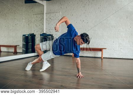 Man Performing Dance Movements On The Floor