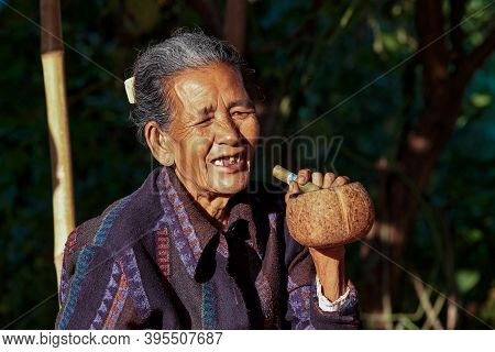 Bagan, Myanmar - Nov 14, 2019: Burmese Woman Smoking A Cigar In Bagan, Myanmar Former Burma In Asia