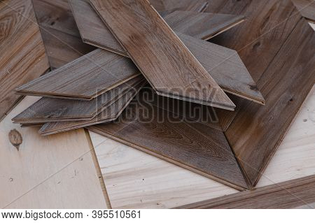 Man Laying Parquet Flooring - Closeup On Male Hands. Worker Joining Parquet Floor