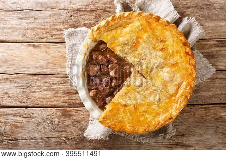 English Beef Steak Pie With Crispy Puff Pastry Close-up In A Baking Dish. Horizontal Top View