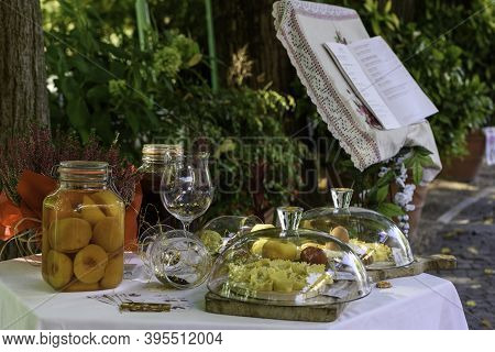 Table Set To Present The Specialties For Lunch On The Mincio River In Borghetto, Verona (italy).