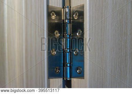 Brand New Door Hinge. Joinery During Repair And Installation Of Doors