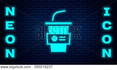 Glowing Neon Paper Glass With Drinking Straw And Water Icon Isolated On Brick Wall Background. Soda