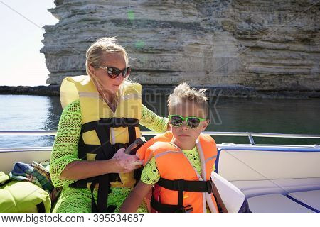 Boat Trip On The Sea Along The Rocky Coast. Family On A Boat Trip. Turquoise Water And Blue Sky On A