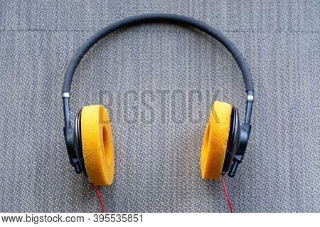 Old Used Headphones With Orange Sponge Cushions