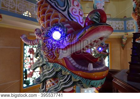 Hoi An, Vietnam, November 19, 2020: Dragon With Illuminated Eyes In The Main Hall Of Worship Of The