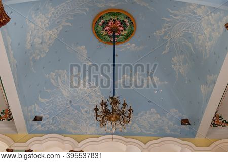 Hoi An, Vietnam, November 19, 2020: Lamp On The Ceiling Of The Main Hall Of The Cao Dai Temple In Ho