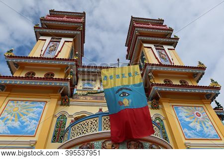 Hoi An, Vietnam, November 19, 2020: Banner With The All-seeing Eye Between The Two Towers Of The Mai