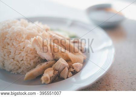 Hainanese Chicken Rice Or Steamed Chicken Rice In White Dish