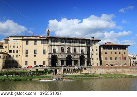 Florence, Italy - Old Town Cityscape Of Arno Riverfront With Uffizi Gallery.