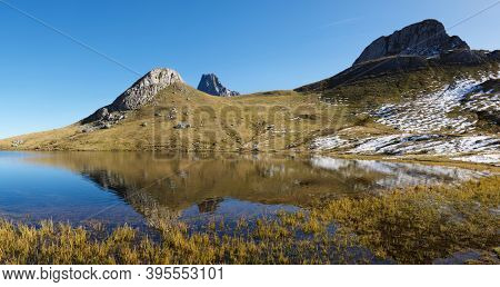 Peaks and Paradis lake. Ayous Lakes in Ossau Valley, Pyrenees National Park, Pyrenees in France.