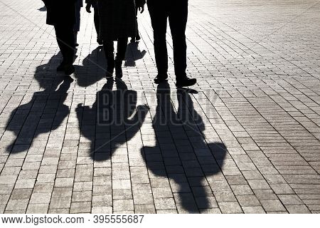Silhouettes And Shadows Of People On The City Street. Crowd Walking Down On Sidewalk, Concept Of Cri