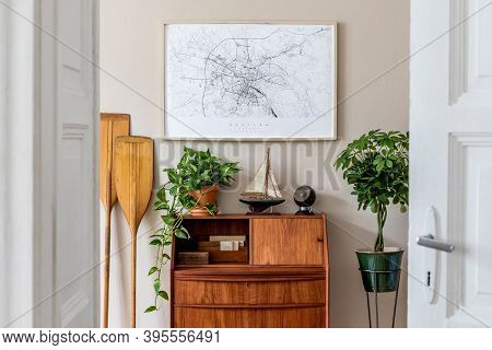Stylish And Vintage Interior Design Of Living Room With Wooden Retro Commode, Plants, Ships, Paddle,