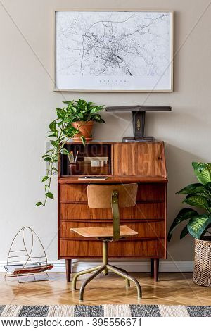 Stylish And Vintage Interior Design Of Living Room With Wooden Retro Commode, Chair, Plants, Ships,