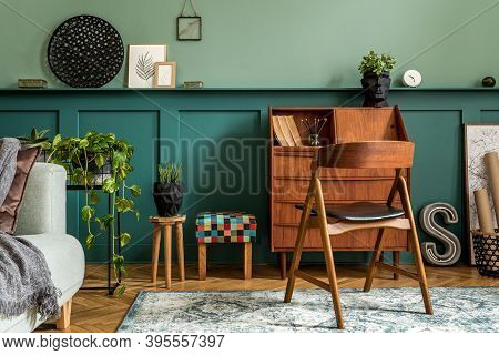 Modern And Retro Composition Of Home Office Interior With Wooden Cabinet, Chair, Plants, Decoration