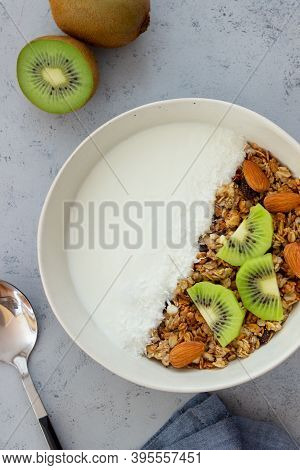 Muesli With White Yogurt, Kiwi And Coconut. Granola. Healthy Eating. Vegetarian Food. Breakfast.