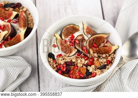 Healthy And Delicious Breakfast. Oatmeal Muesli With Greek Yogurt, Fresh Figs, Dried Fruits And Pome