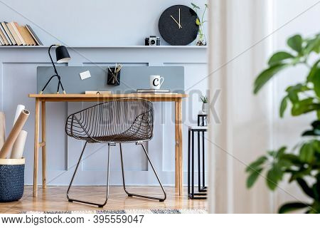 Scandinavian Home Office Interior With Wooden Desk, Design Chair, Wood Panleing With Shelf, Plant, T