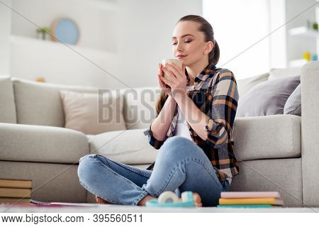 Photo Of Beautiful Young Overjoyed Lady Student Sitting Floor Hold Hot Coffee Cup Hands Eyes Closed